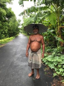 tribal man with hat